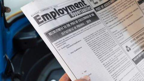 A man reads the executioner job advertisement in a newspaper in Colombo, Sri Lanka.