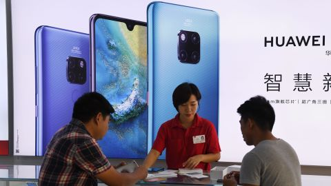 This photo taken on December 8, 2018 shows customers being served at a Huawei stand in a store in Sanya on China's tropical Hainan Island. - China's ambitious drive to dominate next-generation 5G technology faces a sudden reality check as fears spread that telecom companies like Huawei could be proxies for Beijing's intrusive security apparatus. (Photo by Greg Baker / AFP) / TO GO WITH China-US-telecommunication-diplomacy-Huawei-5G, FOCUS by Dan Martin        (Photo credit should read GREG BAKER/AFP/Getty Images)