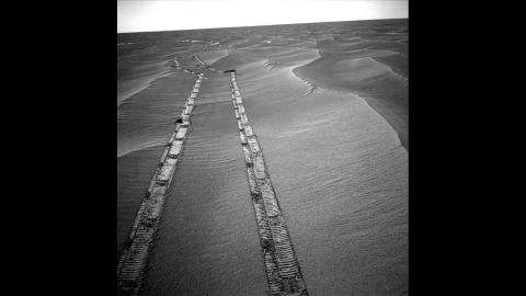 """Sometimes, when Opportunity's solar power was limited, it would stop between treks to different features on Mars. This 2010 photo of its tracks on the surface show it """"hopping from lily pad to lily pad."""""""