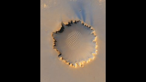 The Mars Reconnaissance Orbiter took this photo of Victoria Crater, about a half-mile in diameter. It was Opportunity's home for 14 of the first 46 months it spent on Mars.