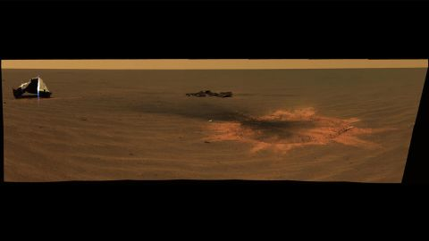 Opportunity made an impact. A panoramic image shows the heat shield impact site when it landed in 2004.