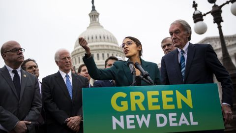 Representative Alexandria Ocasio-Cortez, a Democrat from New York, speaks as Senator Ed Markey, a Democrat from Massachusetts, right, listens during a news conference announcing Green New Deal legislation in Washington, D.C., U.S., on Thursday, Feb. 7, 2019. A sweeping package of climate-change measures unveiled Thursday by Ocasio-Cortezdrew a tepid response from House SpeakerNancy Pelosiwho didn't explicitly throw her support behind the measure. Photographer: Al Drago/Bloomberg via Getty Images