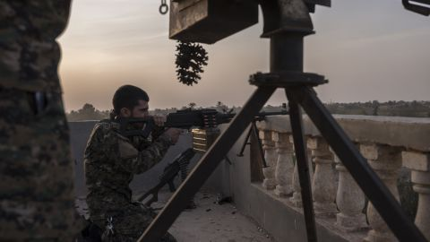 SDF fighters exchange fire with ISIS on the outskirts of Sousa, Syria in October.