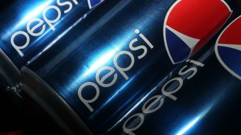 MIAMI - MARCH 22: In this photo illustration cans of Pepsi sodas are seen on March 22, 2010 in Miami, Florida.  PepsiCo announced plans to cut sugar, fat, and sodium in its products to address health and nutrition concerns. The maker of soft drinks including Pepsi-Cola, Gatorade also makes Frito-Lay brand snacks.  (Photo Illustration by Joe Raedle/Getty Images)