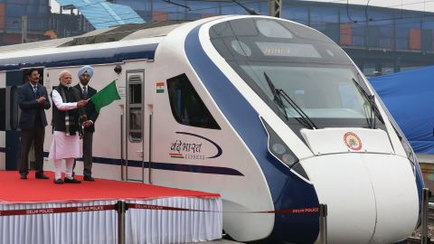 In this photo taken on February 15, 2019, Indian Prime Minister Narendra Modi (2nd L) flags off India's first semi-high speed express train Vande Bharat Express at New Delhi Railway Station. - India's first semi-high speed express train February 16 broke down on the tracks for hours after it crashed into cattle, a day after being flagged off by Prime Minister Narendra Modi. (Photo by STR / AFP)        (Photo credit should read STR/AFP/Getty Images)