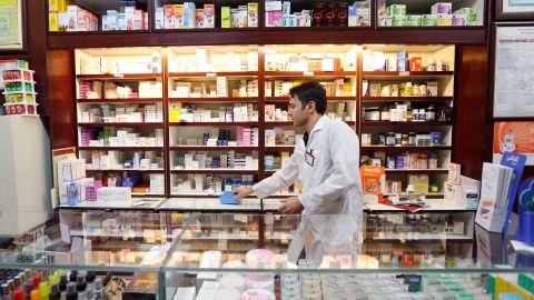 An Iranian man works at a drugstore at the Nikan hospital in Tehran.