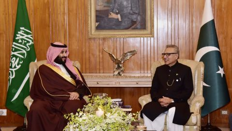 Bin Salman (left) met with Pakistani President Arif Alvi in Islamabad on February 18.