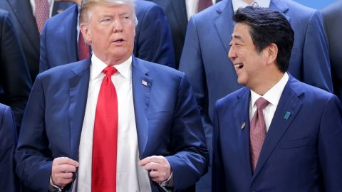 BUENOS AIRES, ARGENTINA - NOVEMBER 30: (L-R) President of  U.S. President Donald Trump and Prime Minister of Japan Shinzo Abe talk during the family photo opening day of Argentina G20 Leaders' Summit 2018 at Costa Salguero on November 30, 2018 in Buenos Aires, Argentina. (Photo by Daniel Jayo/Getty Images)