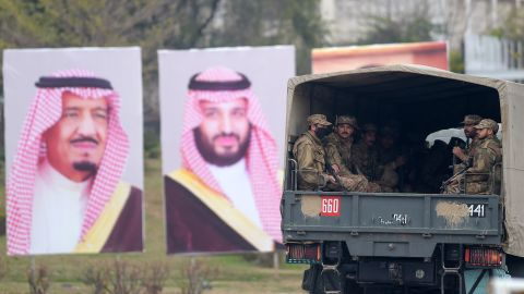 """Pakistani soldiers (R) patrol on a street next to welcoming posters of Saudi Arabian Crown Prince Mohammed bin Salman in Islamabad on February 17, 2019. - Saudi Arabia's powerful crown prince arrives in Pakistan on February 17, the start of an Asian tour during which he will seek lucrative contracts and demonstrate he still has allies five months after the Khashoggi affair. Mohammed bin Salman, widely known as """"MBS"""", is expected to land in the capital Islamabad and stay in Pakistan until February 18. (Photo by AAMIR QURESHI / AFP)        (Photo credit should read AAMIR QURESHI/AFP/Getty Images)"""