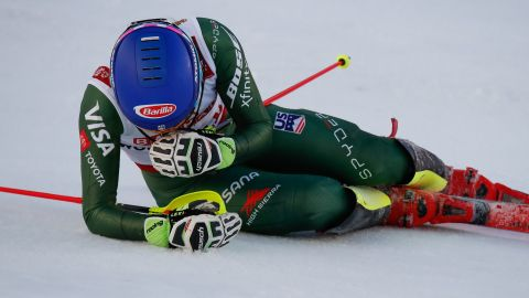 Mikaela Shiffrin collapses to the ground in delight as she wins her fourth consecutive gold in the slalom at the World Ski Championships.