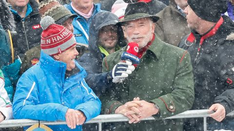 """""""He's back...!"""" Muscleman, movie star and politician Arnold Schwarzenegger takes in the action during his regular visit to the Hahnenkamm races in Kitzbuhel."""