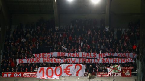 Bayern fans display a banner as they protest against ticket prices during the Champions League  match at Anderlecht in 2017.