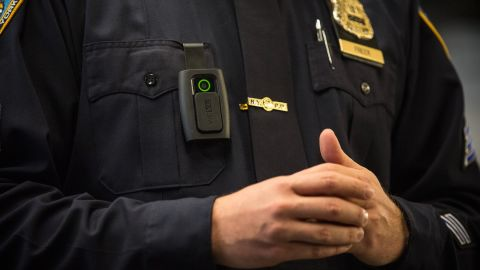 NYPD Sgt. Joseph Freer demonstrates how to use a body camera during a press conference in 2018.