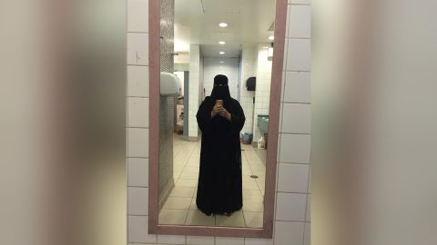 This photo was taken at the toilet airport during a trip to Turkey. The sisters wore this type of niqab when they were traveling outside Saudi Arabia.