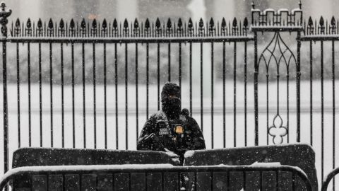 A guard stands in front of the White House on Thursday.