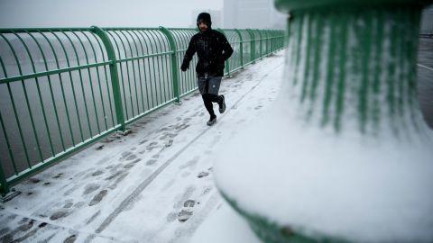 A man runs across the Key Bridge in Washington D.C. on Wednesday.