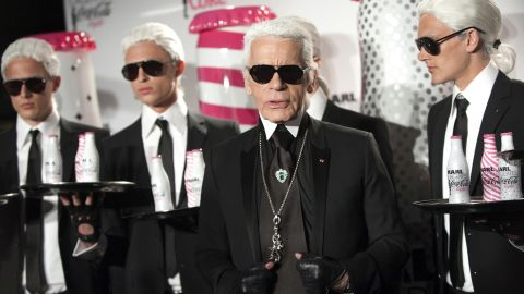 German fashion designer and photographer Karl Lagerfeld poses with models during the launch party of Coke diet (Coca Cola Light) in Paris on April 7, 2011. AFP PHOTO BERTRAND LANGLOIS (Photo credit should read BERTRAND LANGLOIS/AFP/Getty Images)