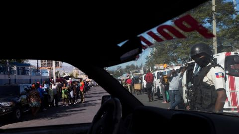 Police agents block the street where a police officer was fatally shot in Port-au-Prince on Wednesday, February 20.