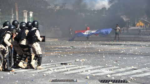Police try to break up a protest in front of the National Palace in Port-au-Prince on February 13.