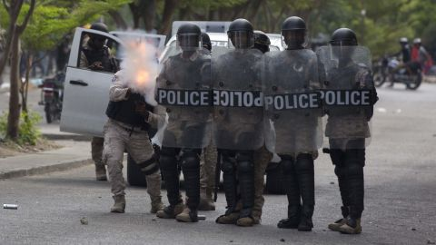 Tear gas is fired as police advance on protesters on February 12.
