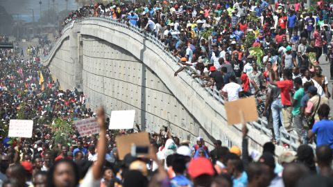 Demonstrators march through the streets of Port-au-Prince, Haiti, on Thursday, February 7, demanding the resignation of Haitian President Jovenel Moise.