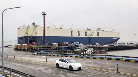Tesla Model 3's roll off a ship at Shanghai's port. (Click to expand.)