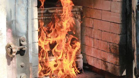 Coffin burning in crematory.