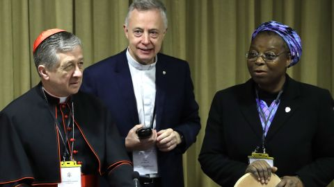 Sister Veronica Openibo stands next to Chicago Archbishop Cardinal Blase J. Cupich, left, and Father Tomaz Mavric as they wait for the Pope's arrival at the beginning of the third day of a Vatican's conference on clergy sex abuse.