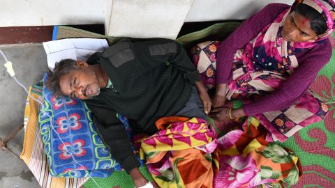 An Indian patient who drank toxic bootleg liquor is treated at Kushal Konwar Civil Hospital in Golaghat district in the northeastern Indian state of Assam on February 23, 2019. - Sixty-nine workers have died and at least 200 others have been hospitalised in northeastern India after drinking toxic liquor, officials said February 23, in the latest case of alcohol poisoning in the country. (Photo by Biju BORO / AFP)        (Photo credit should read BIJU BORO/AFP/Getty Images)