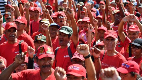 Supporters of President Maduro take part in a march in Caracas on February 23.
