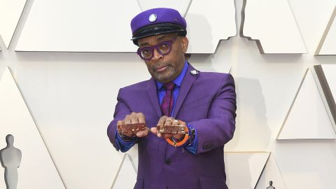 """Spike Lee, nominated in the best director category for """"BlacKkKlansman,"""" paired his purple Ozwald Boateng suit with gold Jordans, a necklace bearing Prince's symbol and rings reading """"Love"""" and """"Hate,"""" a tribute to his 1989 film, """"Do the Right Thing."""""""
