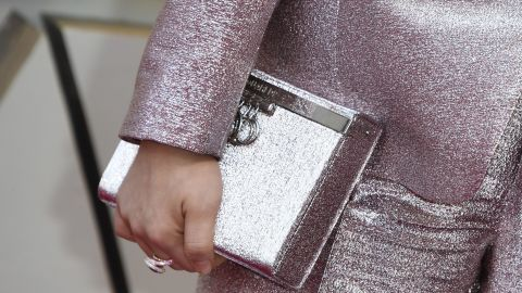 The Crazy Rich Asians star also accessorized with a clutch that doubled as a tequila-filled flask.