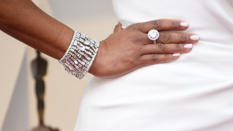 King paired her Oscar de la Renta gown with diamond accessories.