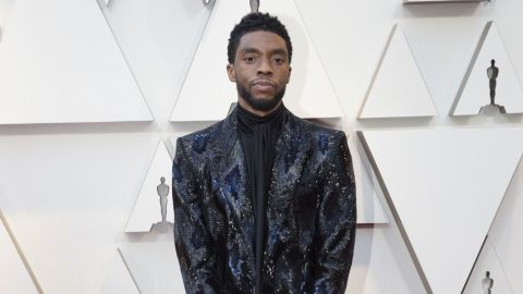 """Award presenter Chadwick Boseman was one of the few men who didn't play it safe, wearing a textured black and blue floor length jacket by Givenchy. The """"Black Panther"""" star consistently wears patterned blazers to red carpet events."""