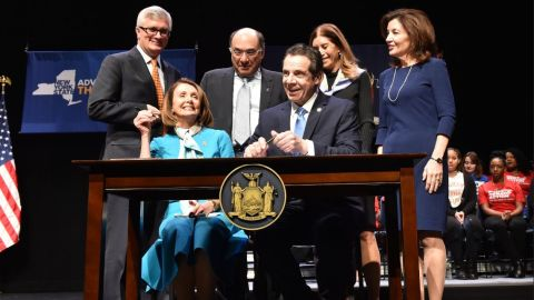 """New York Governor Andrew Cuomo, joined by House Speaker Nancy Pelosi, signed a new 'red flag"""" gun protection bill into law Monday."""
