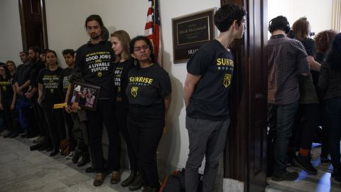 Activists with the Sunrise Movement protest at Senate Majority Leader Mitch McConnell's office in the Russell Senate Office Building on Capitol Hill in Washington on Monday. Activists from around the country joined Kentucky high schoolers trying to confront Mitch McConnell about his rush to vote on the Green New Deal.