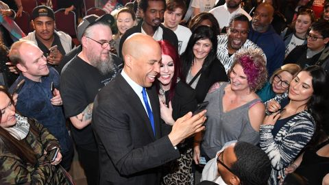 """Sen. Cory Booker takes photos with people after speaking at his """"Conversation with Cory"""" campaign event at the Nevada Partners Event Center on February 24, 2019 in North Las Vegas, Nevada."""