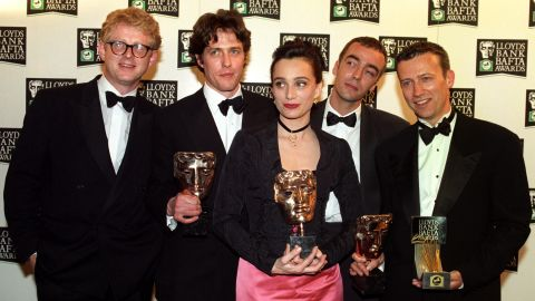 """The cast of """"Four Weddings and a Funeral"""" celebrates its British Academy Film Awards win in 1994 in London."""