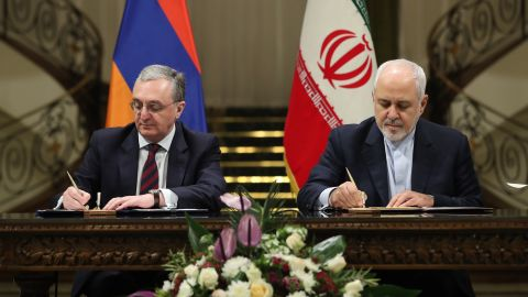 Iran's Foreign Minister Mohammad Javad Zarif, right, signs official documents with Armenian Minister of Foreign Affairs Zohrab Mnatsakanyan.