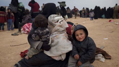 Um Bassam, a supporter of ISIS, sits with her four children after they were evacuated from the group's last town in Eastern Syrian.