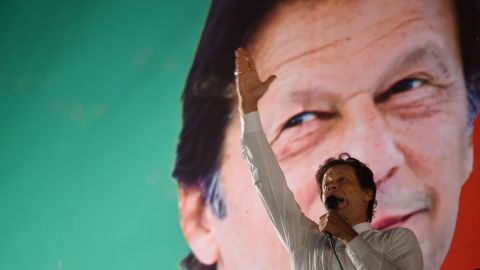 Pakistani cricket star-turned-politician and head of the Pakistan Tehreek-e-Insaf (PTI) Imran Khan gestures as he delivers a speech during a political campaign rally in July 21, 2018.