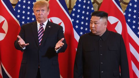 US President Donald Trump, left, and North Korea's leader Kim Jong Un arrive for a meeting at the Sofitel Legend Metropole hotel in Hanoi on February 27, 2019.
