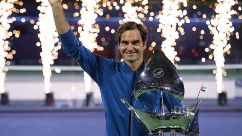 Roger Federer of Switzerland poses with the trophy after claiming his 100th career title.