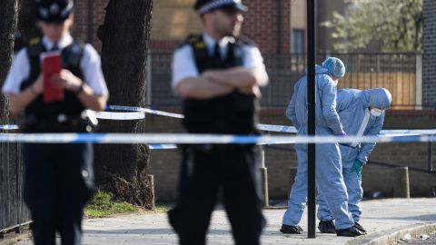 Forensic police officers investigate after a 23-year-old man was fatally stabbed in London in February.