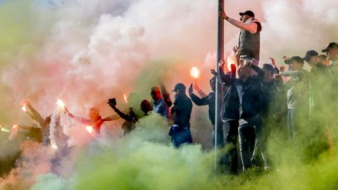 Supporters of the Dutch football team Feyenoord gather on February 26, 2019 at the training field to light flares and sing to the players prior to the final training leading up to the KNVB Cup match between Feyenoord and Ajax. (Photo by Robin UTRECHT / ANP / AFP) / Netherlands OUT        (Photo credit should read ROBIN UTRECHT/AFP/Getty Images)