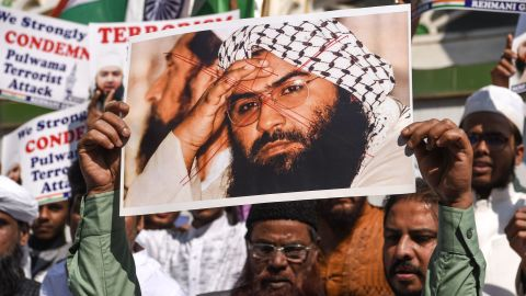 Indian Muslims hold a scratched photo of Jaish-e-Mohammad group chief, Maulana Masood Azhar, as they shout slogans against Pakistan during a protest in Mumbai on February 15, 2019, the day after an attack on a paramilitary Central Reserve Police Force (CRPF) convoy in the Lethpora area of Kashmir. - India and Pakistan's troubled ties risked taking a dangerous new turn on February 15 as New Delhi accused Islamabad of harbouring militants behind the deadliest bombing in three decades of bloodshed in Indian-administered Kashmir. At least 41 paramilitary troops were killed on February 14 as explosives packed in a van ripped through a convoy bringing 2,500 troopers back from leave not far from the main city Srinagar. (Photo by Indranil MUKHERJEE / AFP) / The erroneous mention[s] appearing in the metadata of this photo by Indranil MUKHERJEE has been modified in AFP systems in the following manner: [Jaish-e-Mohammad group chief, Maulana Masood Azhar] instead of [Jamaat-ud-Dawa (JuD) organisation chief, Hafiz Muhammad Saeed]. Please immediately remove the erroneous mention[s] from all your online services and delete it (them) from your servers. If you have been authorized by AFP to distribute it (them) to third parties, please ensure that the same actions are carried out by them. Failure to promptly comply with these instructions will entail liability on your part for any continued or post notification usage. Therefore we thank you very much for all your attention and prompt action. We are sorry for the inconvenience this notification may cause and remain at your disposal for any further information you may require.        (Photo credit should read INDRANIL MUKHERJEE/AFP/Getty Images)