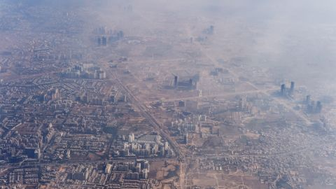 Smog envelops buildings on the outskirts of the Indian capital New Delhi on November 25, 2014.   AFP PHOTO/Roberto SCHMIDT        (Photo credit should read ROBERTO SCHMIDT/AFP/Getty Images)