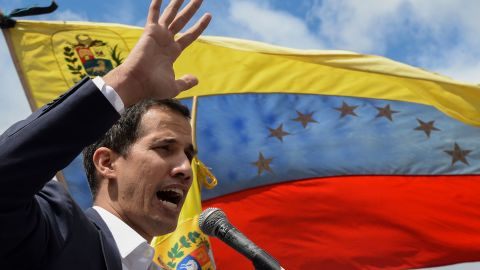 """Venezuela's National Assembly head Juan Guaido speaks to the crowd during a mass opposition rally against leader Nicolas Maduro in which he declared himself the country's """"acting president"""", on the anniversary of a 1958 uprising that overthrew a military dictatorship, in Caracas on January 23, 2019. - """"I swear to formally assume the national executive powers as acting president of Venezuela to end the usurpation, (install) a transitional government and hold free elections,"""" said Guaido as thousands of supporters cheered. Moments earlier, the loyalist-dominated Supreme Court ordered a criminal investigation of the opposition-controlled legislature. (Photo by Federico PARRA / AFP)        (Photo credit should read FEDERICO PARRA/AFP/Getty Images)"""