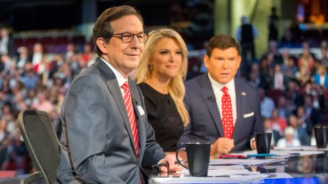 FILE - In this Aug. 6, 2015 file photo, Fox News moderators from left, Chris Wallace, Megyn Kelly and Bret Baier appear for the first Republican presidential debate in Cleveland. Fox News Channel says it will host the seventh Republican presidential debate, taking place next month in Des Moines, Iowa ahead of that state's caucuses. Fox said Monday, Dec. 21, 2015, that the two-hour debate on Jan. 28 will be anchored by Bret Baier, Megyn Kelly and Chris Wallace.  (AP Photo/Andrew Harnik, File)