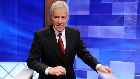 """CULVER CITY, CA - APRIL 17:  Game show host Alex Trebek poses on the set of the """"Jeopardy!"""" Million Dollar Celebrity Invitational Tournament Show Taping on April 17, 2010 in Culver City, California.  (Photo by Amanda Edwards/Getty Images)"""